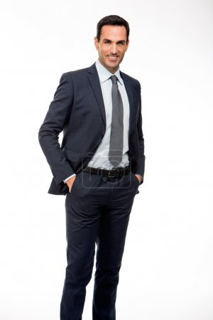 Full length portrait of a smiling businessman with hands in his pockets