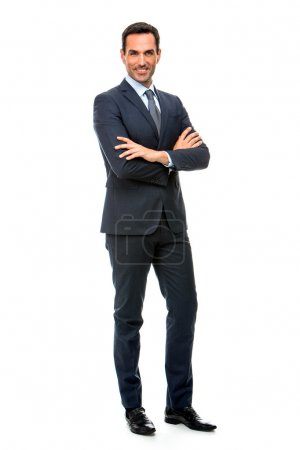 Photo for Full length portrait of a smiling businessman looking at camera with crossed arms - Royalty Free Image
