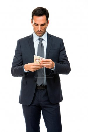 Half length portrait of a businessman counting money