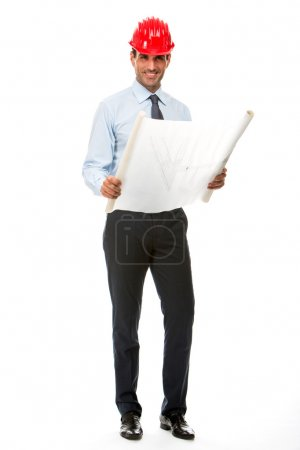 Full length portrait of smiling construction supervisor looking at blueprints