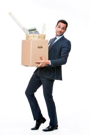 Full length portrait of a businessman carrying a cardboard box