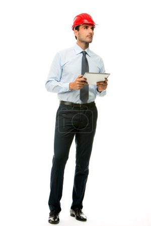 Full length portrait of a construction supervisor with digital tablet looking at a project