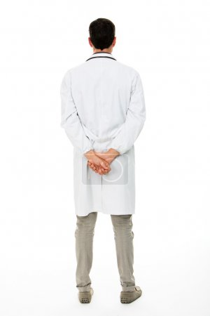 Full length backside view of a male doctor with hands behind his back