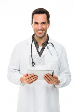 Half length portrait os a smiling male doctor with stethoscope and holding a digital tablet