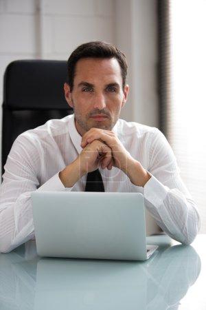 Half length portrait of a thoughtful male businessman