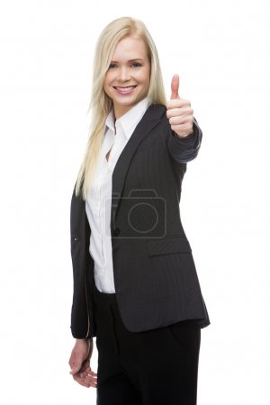 Smiling blonde businesswoman thumb up with one hand
