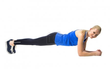 Blonde woman wearing fitness clothing exercising