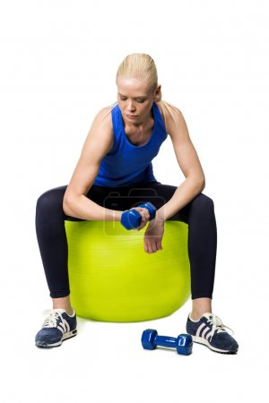Blonde woman exercising with weights