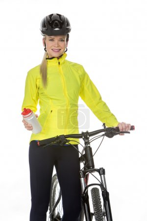 Woman with bike and sport flask