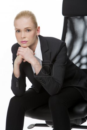 Businesswoman seated on a chair