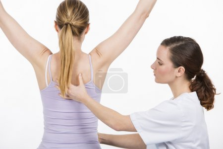 woman with physiotherapist