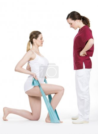 Physiotherapist doing tone with flexible for spine