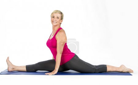 middle age woman doing split exercises