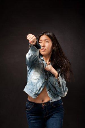 Oriental girl posing in studio