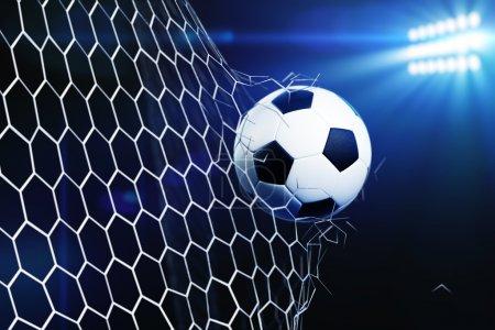 Soccer ball breaking goal net