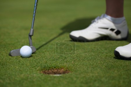 Golfer Tapping In