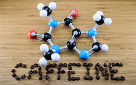 Photo for Caffeine molecule structure (atomic model) with coffee bean align in word on wood background - Royalty Free Image