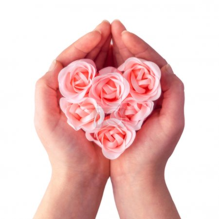 Soap rose heart in hands