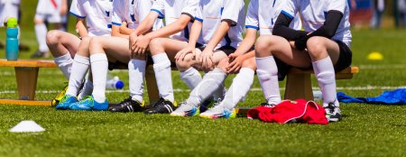Soccer team; Reserve Players on a bench; Boys With Football Coac