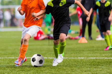 Boys play soccer football match