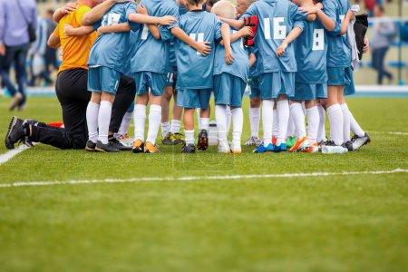 Young Boys In Soccer Football Team With Coach. Motivation Talk Before Soccer Match. Little League Soccer Boys Team.