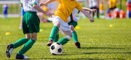 boys playing soccer football match