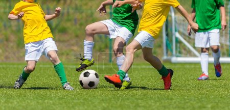 Training and football match between youth teams. Young boys play