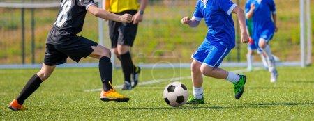 Teens Playing Soccer Football Match