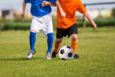 children kicking soccer football ball