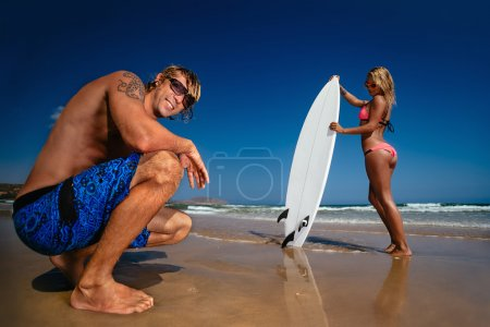 Cheerful surfing couple