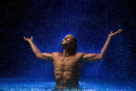 Muscular man in water