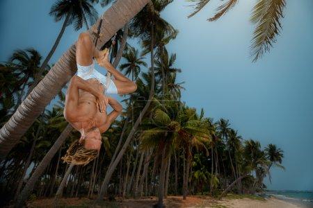 Man doing upside down yoga