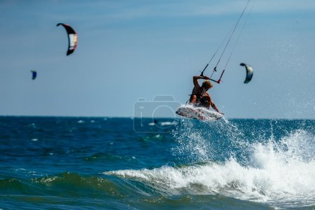 kite surfer rides waves