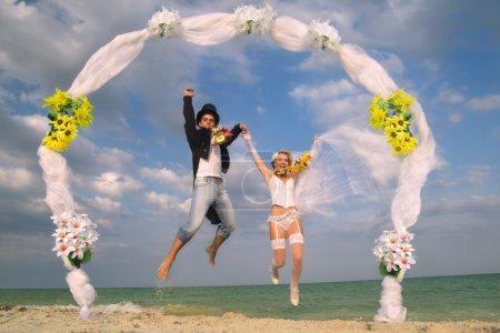 newly-married couple on beach