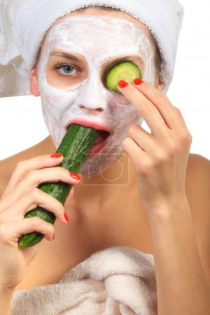 Girl with mask and cucumber