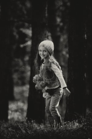 Photo for Little girl running in the forest, black and white - Royalty Free Image