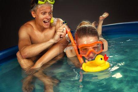Young couple is enjoyin  in pool