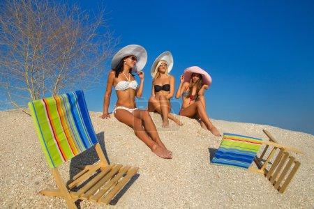 Young women relaxing on beach