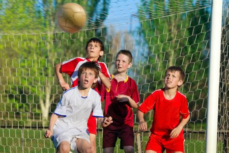 Four Boys playing soccer