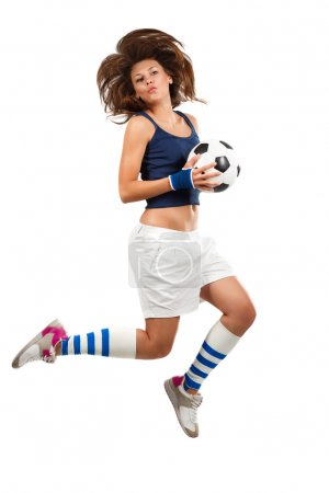 Photo for Girl jumpig with soccer ball in mid air with over white background - Royalty Free Image