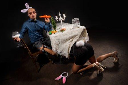 Woman seducing her boyfriend under table
