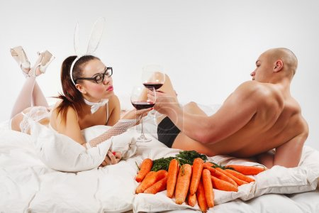 Couple in rabbit costumes with wine
