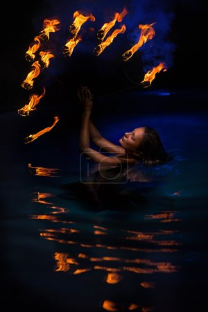 Firedancer woman  in water