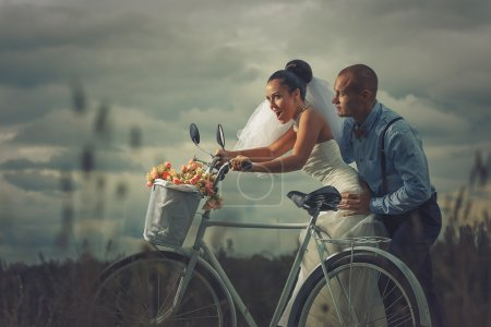Bride and groom on  bicycle