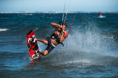 Handsome man Kitesurfing