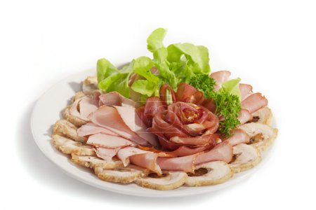 Photo for Big group of thinly sliced meat in the form of rose decorated with parsley and dill - Royalty Free Image