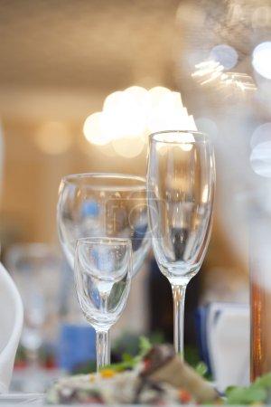 Three wine glasses on fancy table