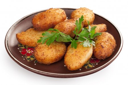 Photo for Pile of chicken Kiev cutlets at plate - Royalty Free Image