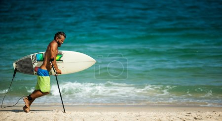 Lame man with surfboard