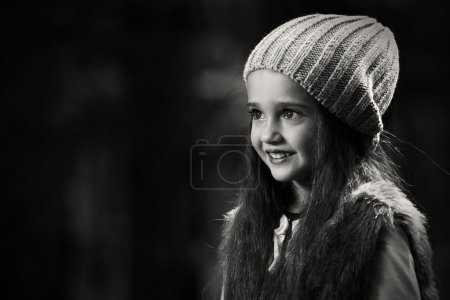 little smiling girl in hat